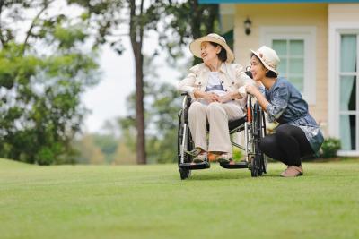 senior woman and caregiver outdoor
