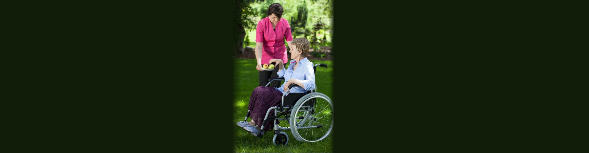 caregiver giving fruits to senior