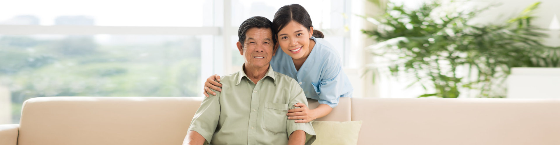 young lady and old man smiling